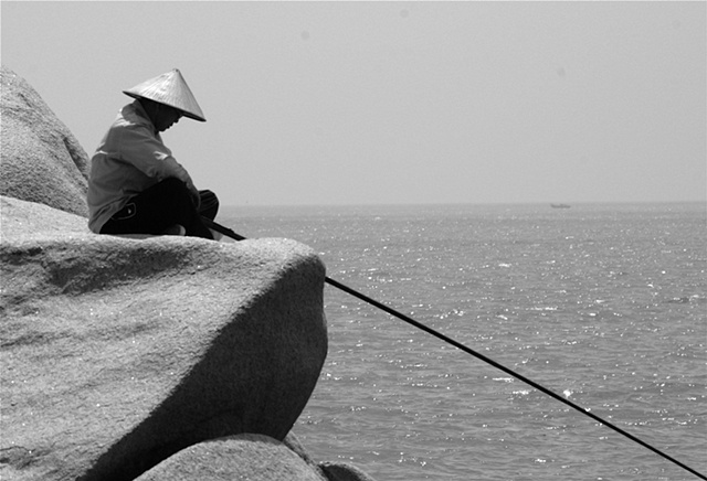 Fisherman on the rocks - Hainan