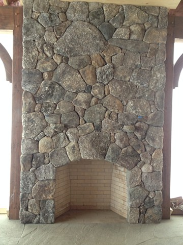 Stone fireplace facing in to the porch.