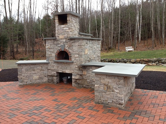 Natural brick and stone outdoor pizza oven with a Forno Bravo core