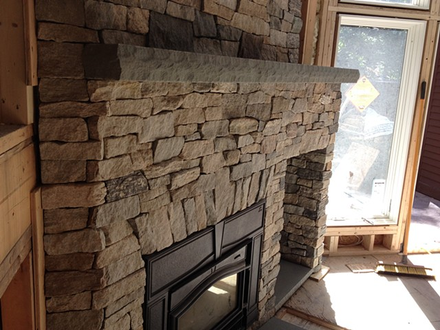 A view of the custom bluestone mantle