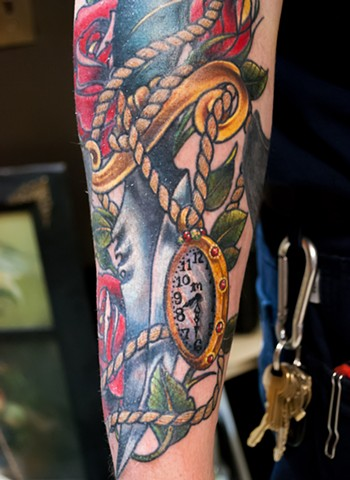 detail of traditional inspired dagger rose and watch tattoo by chris lowe of naked art