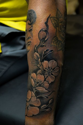 cherry blossom tattoo on arm by chris lowe of naked art tattoos odenton maryland