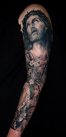 religious sleeve tattoo by chris lowe of naked art tattoos odenton maryland