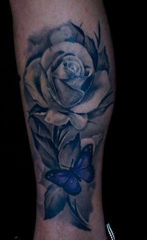 realistic black and grey rose tattoo by chris lowe of naked art tattoos in maryland .