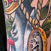 close up of traditional inspired dagger rose and watch tattoo by chris lowe