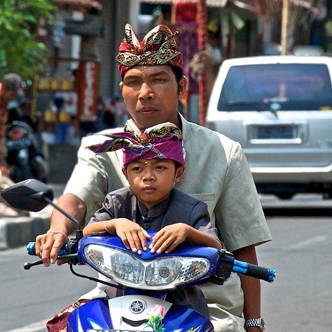 Father and Son on motorcycle in Bali