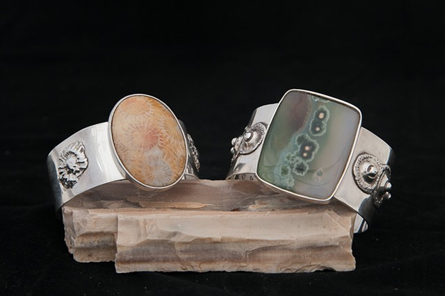 Sterling silver cuffs with fossils. Fossilized cora (left) Ocean Jasper (right)