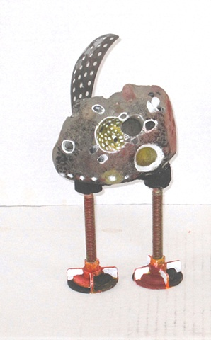Footed Figure with Holes