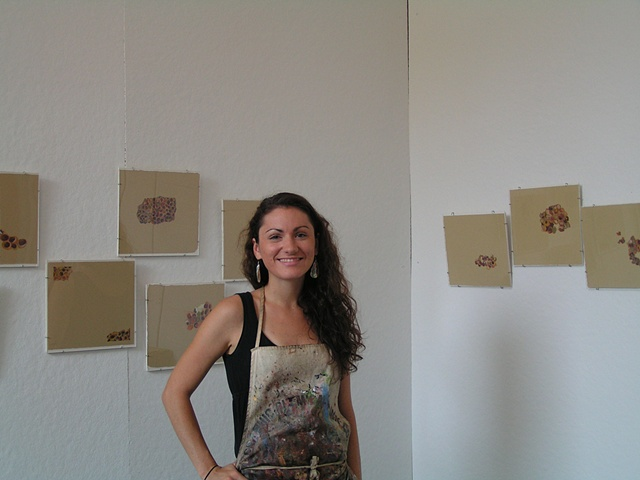 In front of some nest drawings during studio stroll