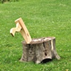 Two stumps and an axe lounge chair