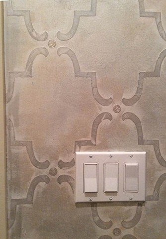 Metallic plaster with mica details in powder room. Detail.