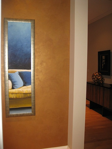Burnished gold plaster wall.