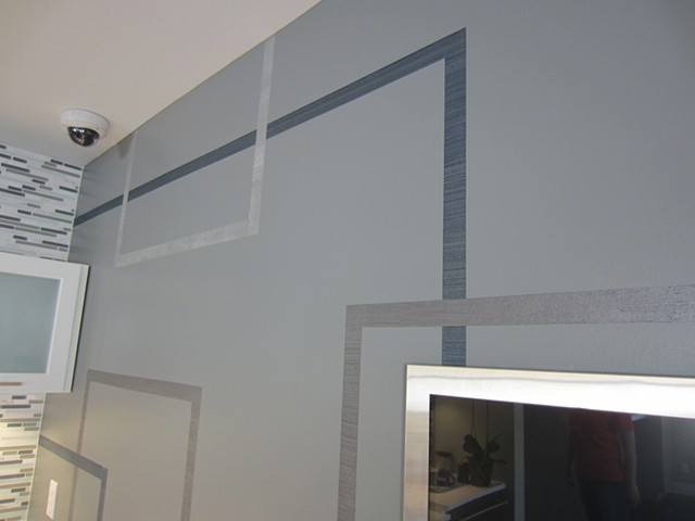 Detail of motif painted for Integration Controls. Lines are made in raised metallic plaster.