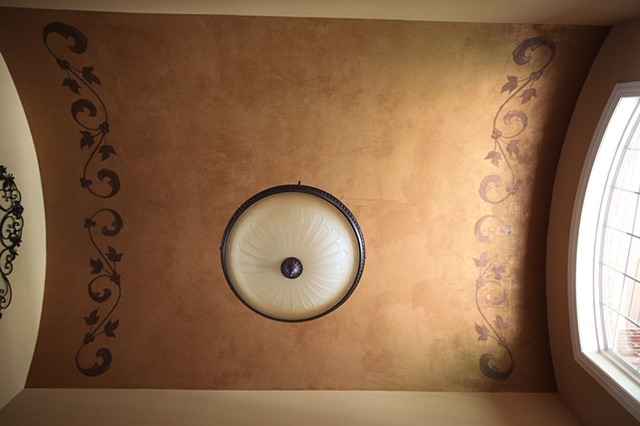 Hand painted pattern on gold finish ceiling.
