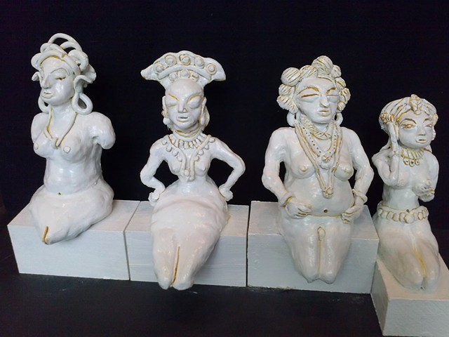Before Kali. seated figurines numbers  23,12 , 13, 16