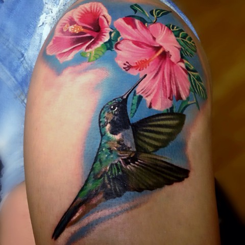 Color Tattoo of a Humming Bird and Flowers