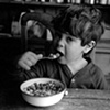 Boy eating cereal
