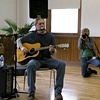 Guitarist performing at Clifton Cultural Arts Center