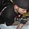 Mike tattooing Piggy D