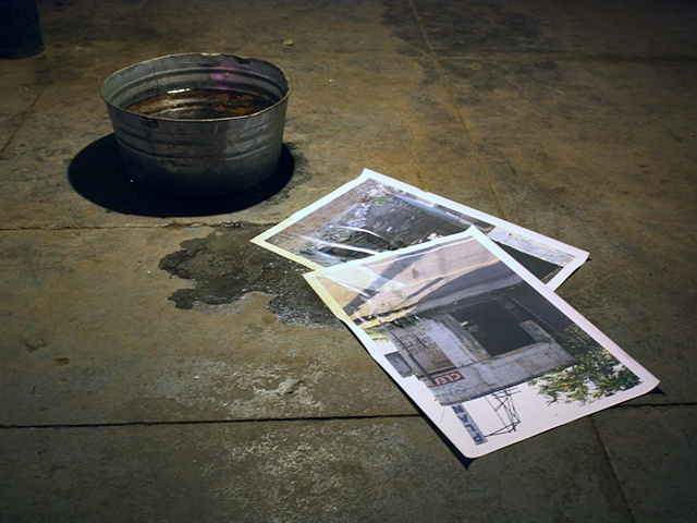sculpture of photograph in artificial puddle by Rena Leinberger