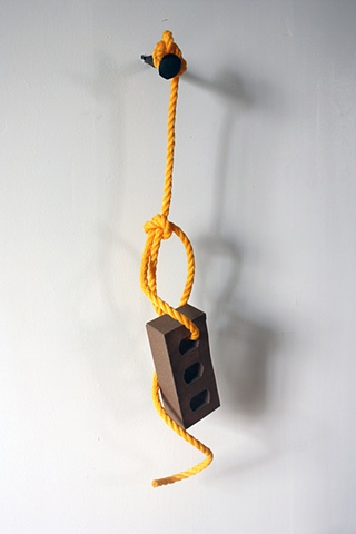 sculpture of sandpaper brick on a rope by Rena Leinberger
