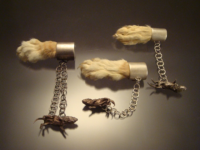 brooch set, taxidermy cat paws, dead mice cast in shibuishi