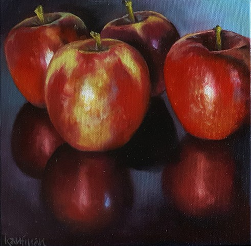 Four Reflective Apples