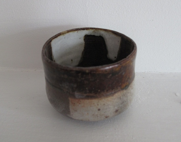 Metallic brown and white tea cup