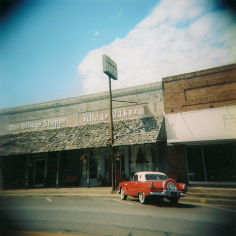 Lomography Holga 120 film photograph of a 1950s Ford in the small town of West, Texas in front of Village Bakery