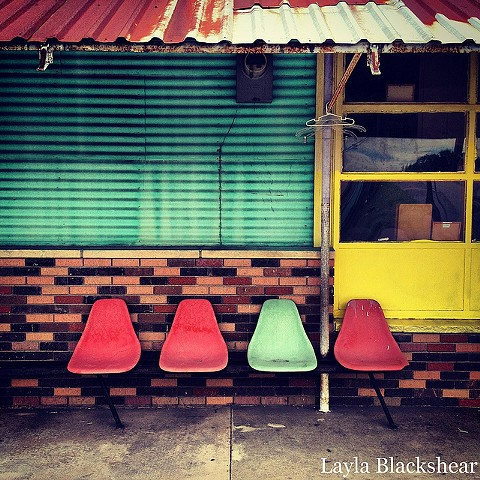 bertram, texas laundromat with colorful and vibrant chairs in turquoise, aqua, teal, salmon, and yellow