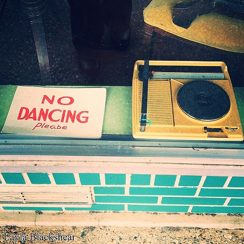 no dancing sign in austin texas record shop with record player and vinyl