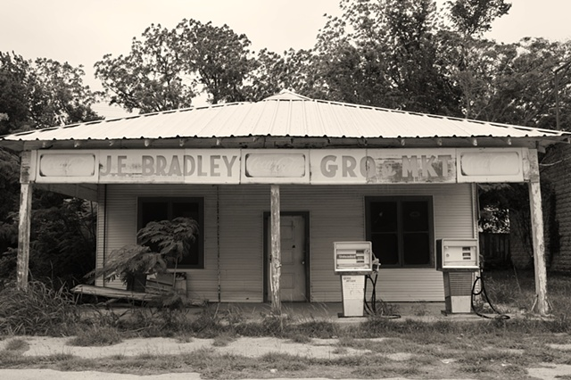 Black and white photograph of old J.E. Bradley grocery and gas station