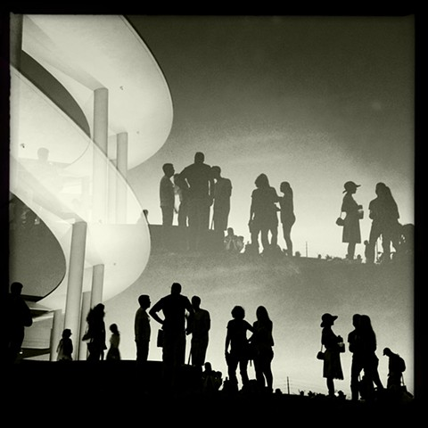 Black and white double exposure of silhouettes at the long center in austin texas