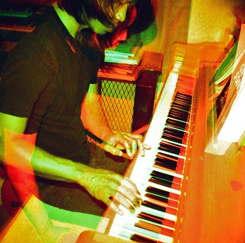 double exposure of jeff playing piano with 3D effect