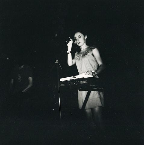 black and white film and lomography holga photograph of fight bite, leanne macomber playing at rubber gloves in denton texas