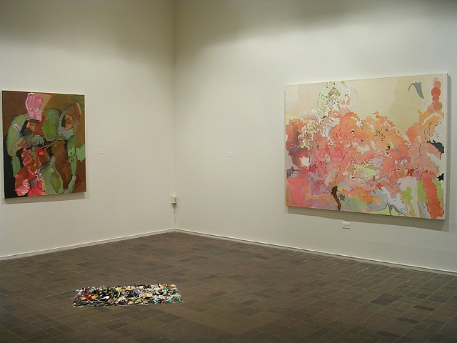 "L to R: Lydia Mullen painting, David Baumflek floor sculpture, Noah Landfield ""The Garden"""