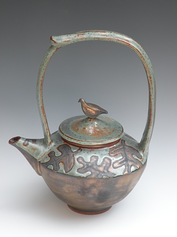 Patina green teapot with gold oak leaves and bird on lid.