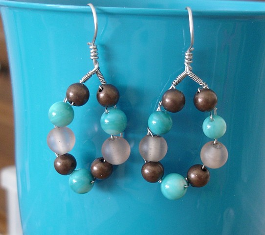 Nickle wire wrapped earrings with bronze, turquoise, and natural bead.