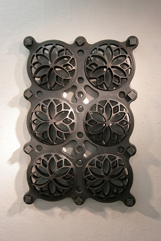 Cast-iron sculpture, while sculpture, repetitive pierced form. By Vaughn Randall