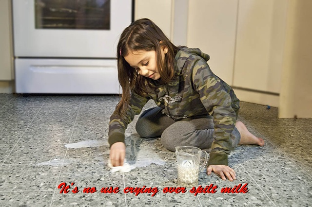 Girl cleaning up spilt milk