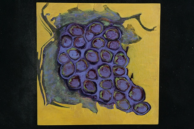 purple grapes on yellow