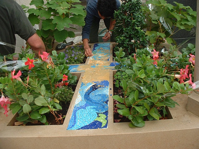 Removing the paper from the mosaics.