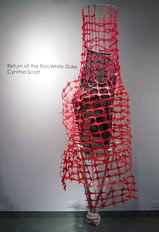 Mixed media suspended sculpture about institutional racism and incarceration