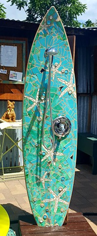 """Sea Stars"" Custom Surfboard Shower On display at Chicweed Patio & Garden 240 S Cedros Ave, Solana Beach, CA Recycled surfboard with cut glass"