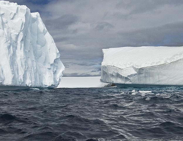 dramatic icebergs antarctica stormy day