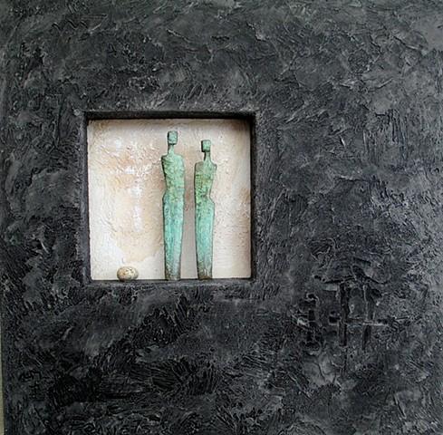 Verdigris figures with stone