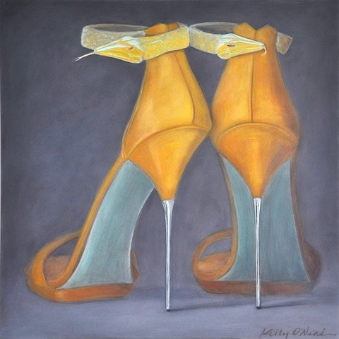 Golden yellow shoes with snake styled ankle straps and turquoise blue soles.