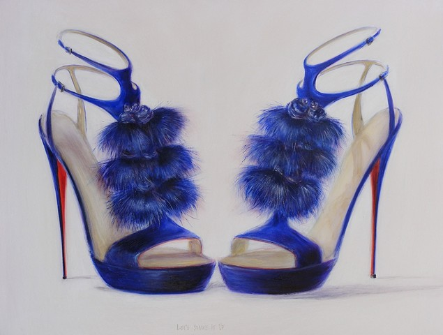 Blue shoes with blue tassels and red soles.