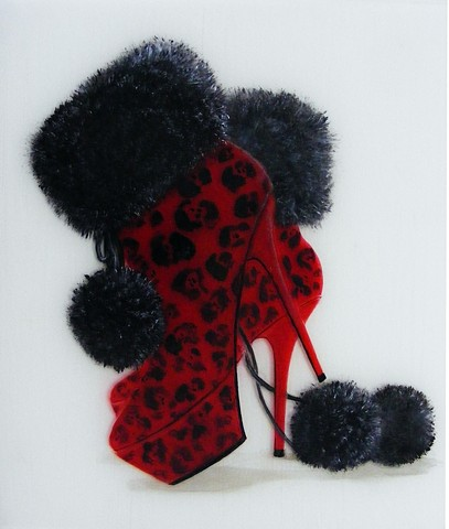 Red high heeled booties with black fur trim and pom-poms and leopard print.