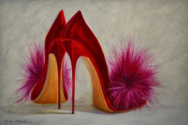 Red high heeled shoes with hot pink puffs.